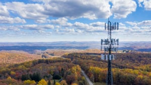 rural broadband: a cell phone tower over a long stretch of hills and forest