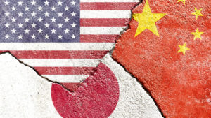 A concept image of the flags of the United States, China, and Japan juxtaposed on concrete slabs jutting into each other.