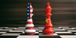 US America and China flags on chess kings on a chess board