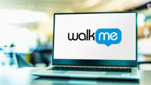 Laptop computer displaying logo of WalkMe, a software-as-a-service (SaaS) company that helps users navigate the features of other web-based services.