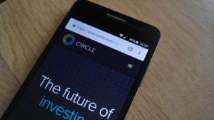 The logo for Circle is displayed on a smartphone screen.