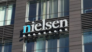 The logo for Nielsen Holdings is displayed on the side of a building.