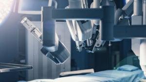 robotic arms over medical bed symbolizing medical robotics