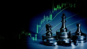 A photo of chess pieces and coins on a table with a stock chart superimposed over top.