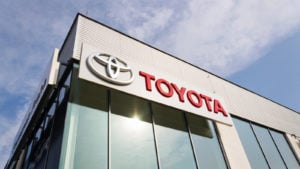 Toyota motor corporation logo on dealership building