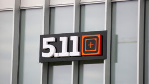 The logo for 5.11, a holding of private equity company Compass Diversified Holdings, is seen on the side of a building.