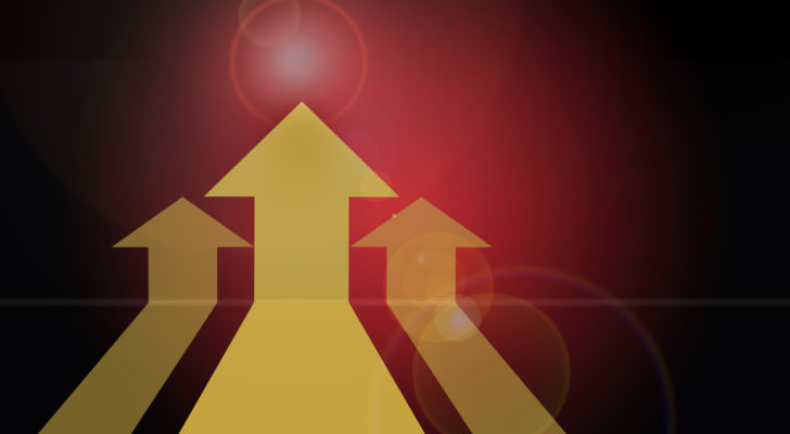 An image of three yellow arrows on a red background.