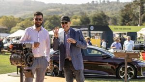 Lucid Motors (LCID) CEO Peter Rawlinson flashes four fingers at a company event