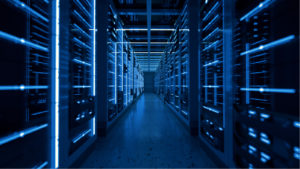 A hallway with server racks on either side in a data center