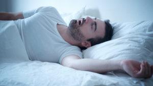 Man suffering from sleep apnea.