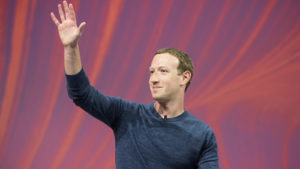 A photo of Mark Zuckerberg waving at a press conference at VIVA Technology in 2018.