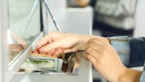 bank stocks A customer makes a transaction at a bank