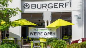 A photo of the exterior of a Burgerfi (BFI) restaurant.