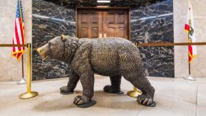 A photograph of a statue of a California grizzly in front of the California governor's office.