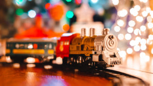 A toy train in front of a Christmas tree representing 2021 Christmas toy shortage.
