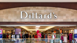 A photo of the exterior of a Dillard's (DDS) store with the company logo above the entrance.