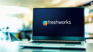 The logo for Freshworks (FRSH) is displayed on a laptop screen.