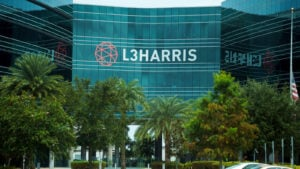 An office building with the logo for L3Harris Industries visible on the building.
