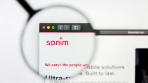 The Sonim Technologies website with a magnifying glass over it representing SONM stock.