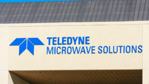 The logo for Teledyne (TDY) is seen on the side of a building.
