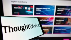 The ThoughtWorks (TWKS) logo is displayed on a smartphone screen.